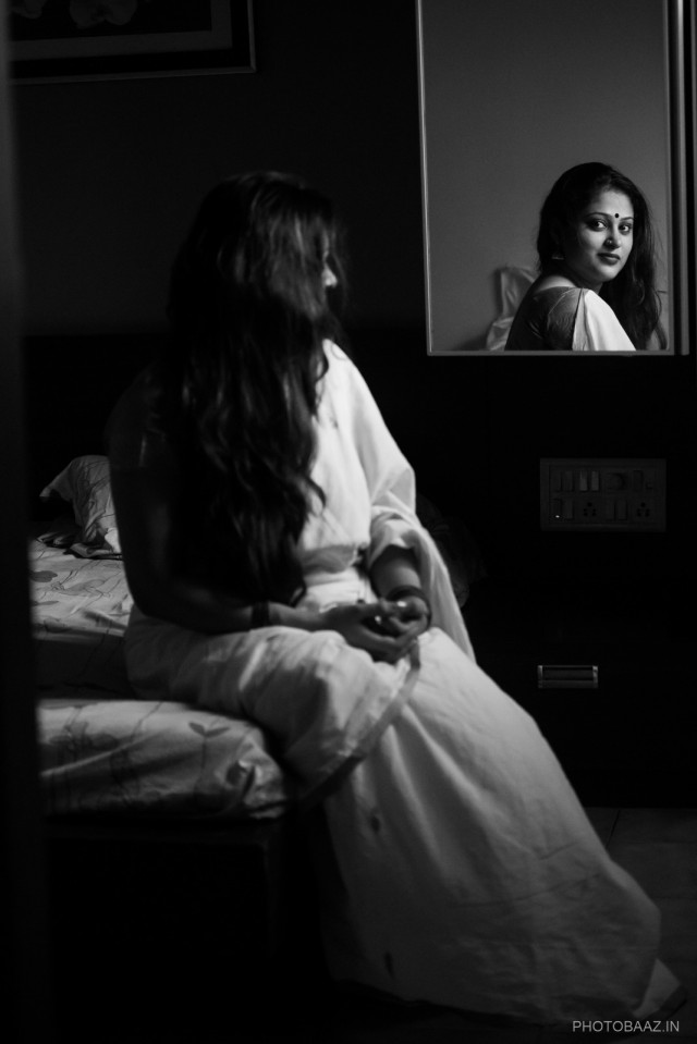 Shilpi Natasha Nath - traditional indian woman in a sari sitting before a mirror and being reflected